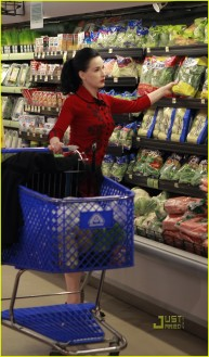 "#7011821 Exclusive...Cointreau spokeswoman and artistic director of Cointreau Prive and iconic burlesque performer Dita Von Teese gets her grocery shopping done in Los Angeles, CA on March 20, 2011. Despite it being pouring rain outside Dita managed to look her best in her signature ""Wheels & Dolls Baby Dita Rose"" cardigan that she designed herself. Fame Pictures, Inc - Santa Monica, CA, USA - +1 (310) 395-0500"